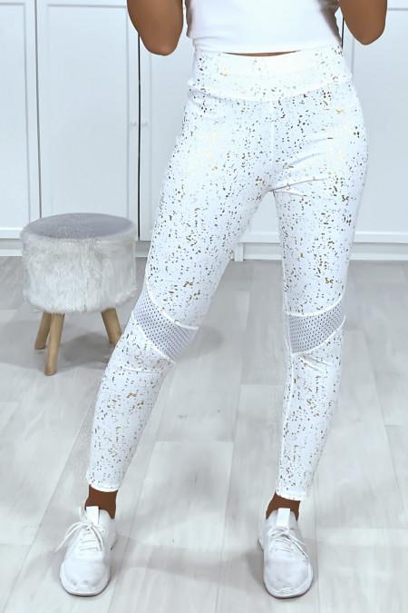 Zeer sportieve witte legging in push-up stijl met gouden stippen en mesh op de knieën