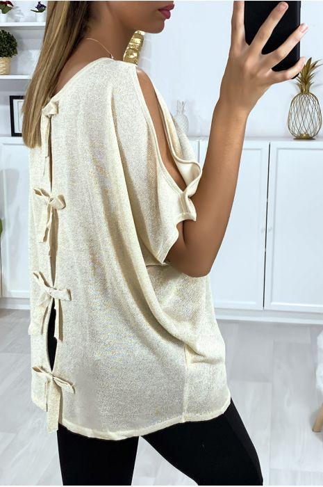Beige top van glanzende stof met blote schouders en strikjes op de rug