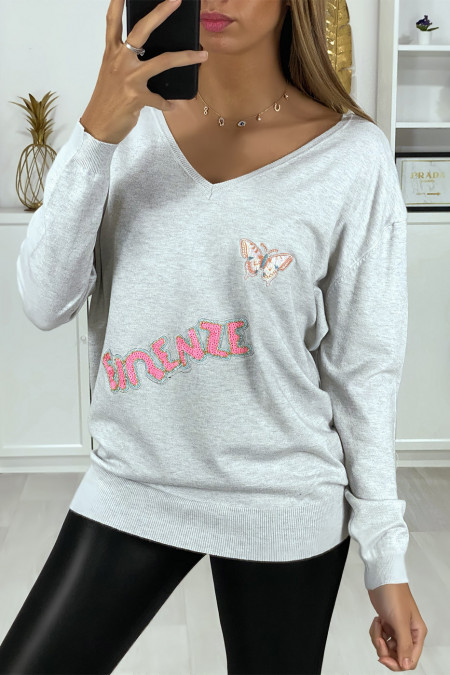 Very soft gray V-neck sweater with writing and embroidered butterfly
