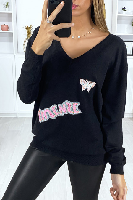 Very soft black V-neck sweater with writing and embroidered butterfly