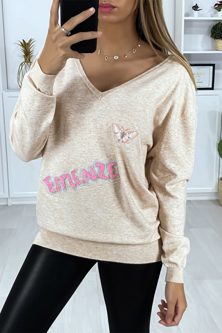 Very soft pink V-neck sweater with writing and embroidered butterfly