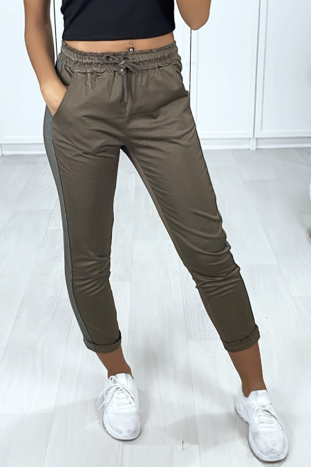 Slim khaki jogging rolled up at the bottom with slightly glittery bands
