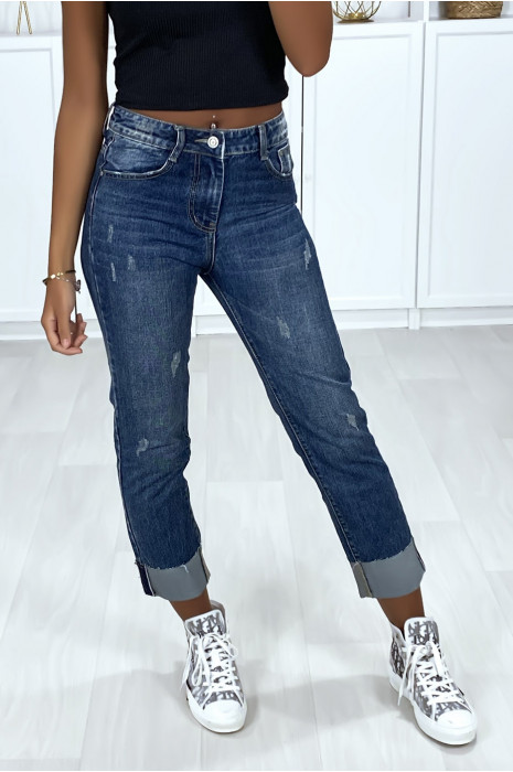 Faded and distressed boyfriend jeans with ankle cuffs.