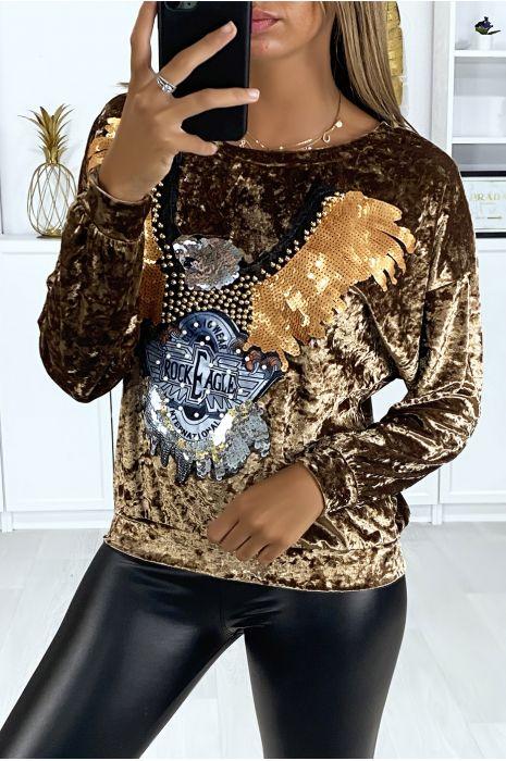Haute en velours doré avec motif pailleté à l'avant