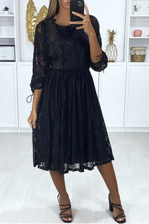 Black dress lined in lace with embroidery