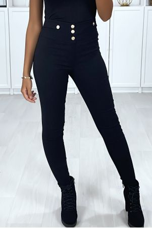 Black stretch slim pants with gold buttons on the front and back pockets