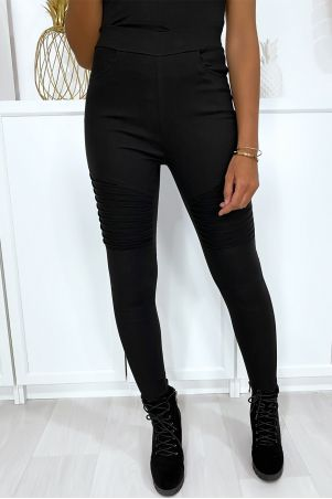 Black stretch slim-fit pants with biker-style pleats at the knees