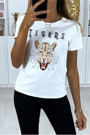 T-shirt blanc avec dessin devant et boutons doré aux épaules