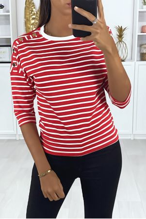Red and white striped top with gold buttons on the shoulders