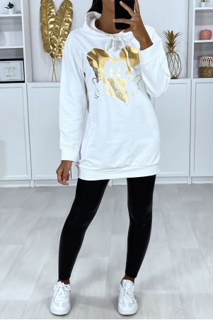 Long white hoodie with gold design on the front