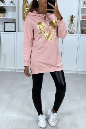Long pink hoodie with gold design on the front