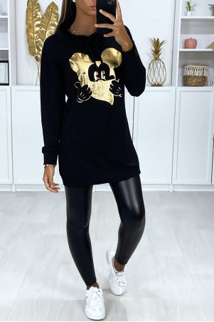 Long black hoodie with gold design on the front