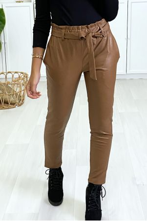 Camel carrot cut pants with gathered waist and belt.
