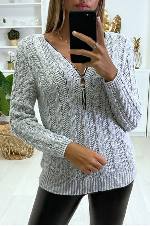 Gray cable-knit sweater with adjustable zip collar.