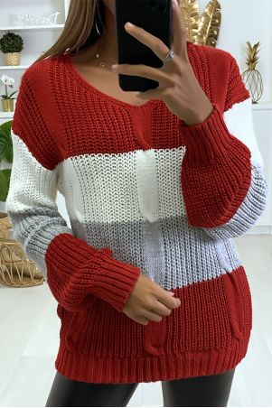 Tricolor sweater with red dominance in cable knit.