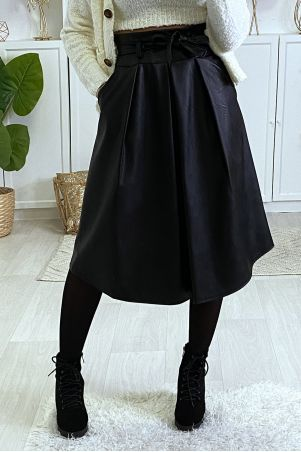 3/4 black faux leather skirt with pleated pockets and belt.
