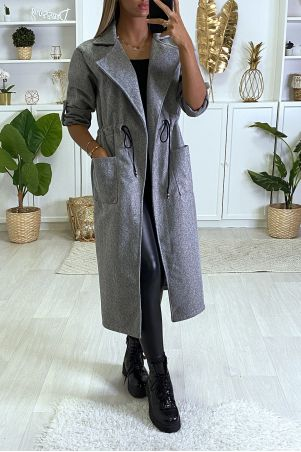 Long gray coat fitted at the waist with pockets